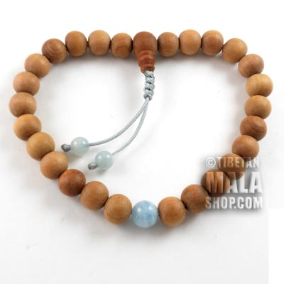 sandalwood wrist mala beads with aquamarine