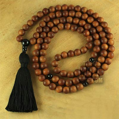 sandalwood mala tassel with onyx