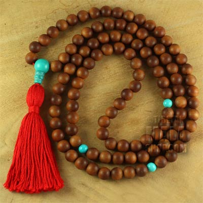 sandalwood mala tassel with turquoise